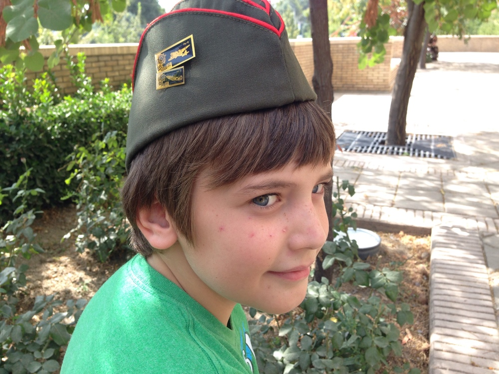 Russian hat, or so we believe, and plane pins - one happy boy