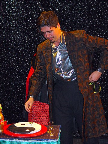 Performing the needle swallowing act at a corporate function.