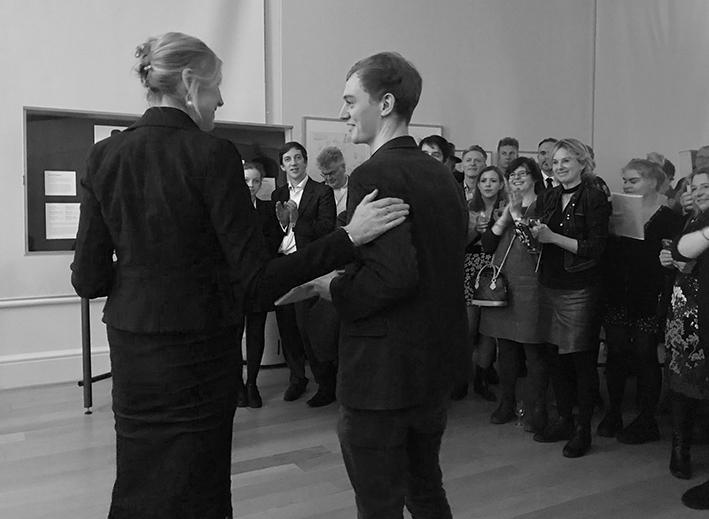 Illustrator James Bailey receives his award from Children's Laureate Lauren Child.