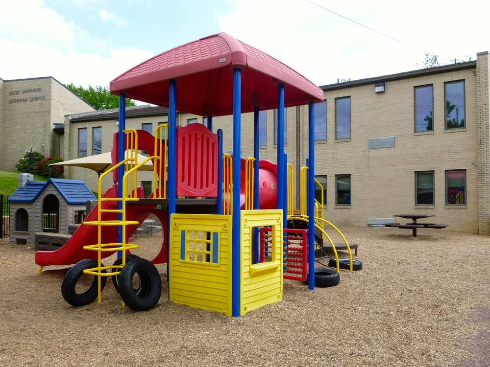 Our kid-friendly playground sits in front of our classroom building.