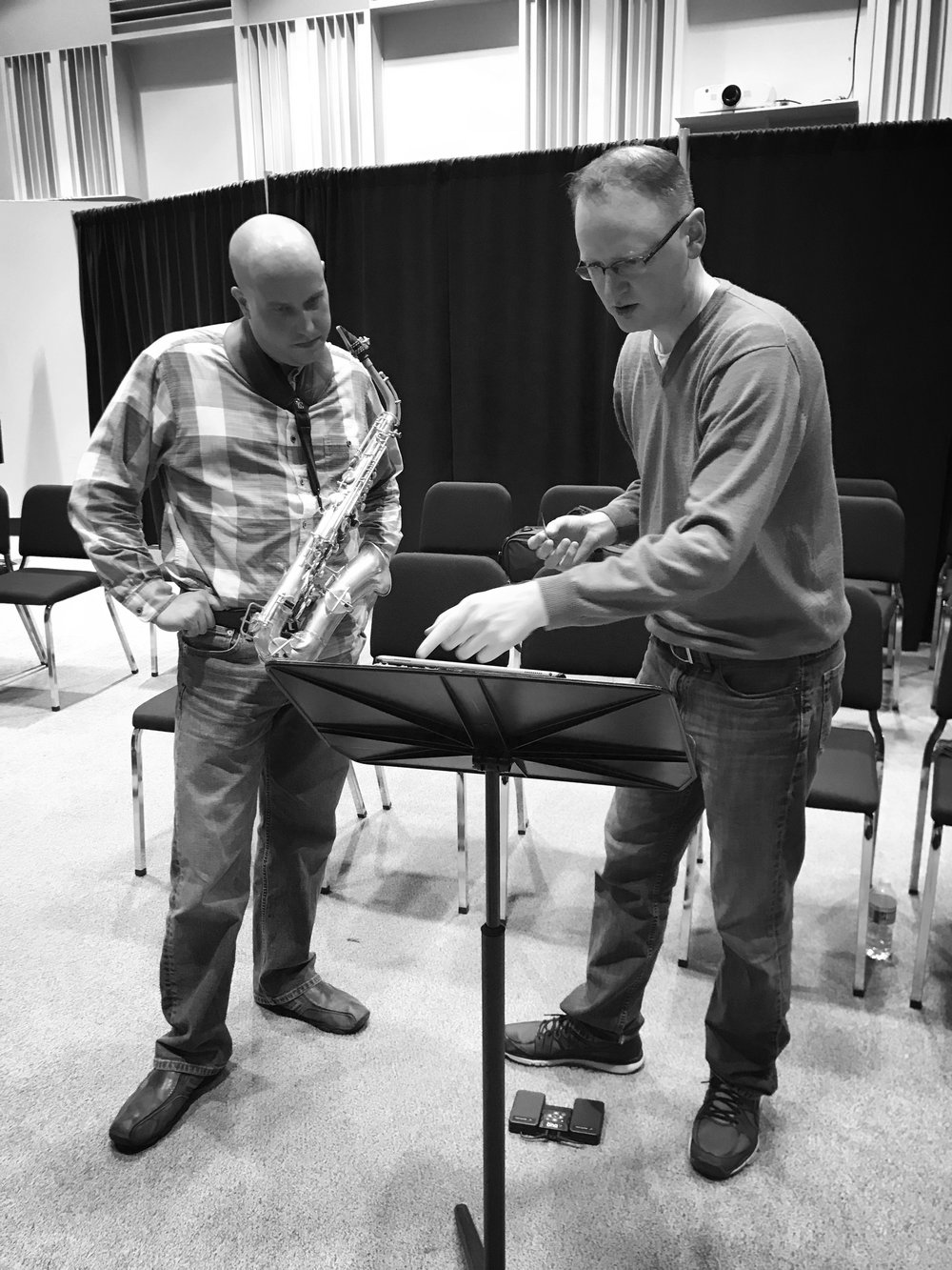 RSO performers Marc Ballard and Chris Condon examining the details of a composition