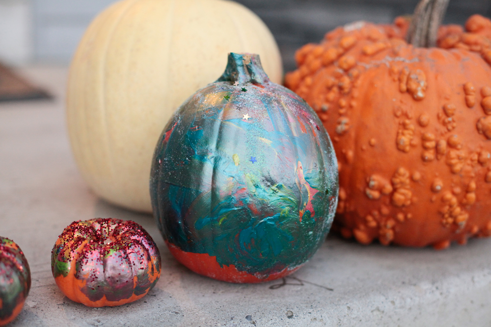 we didn't carve pumpkins this year, instead the kids had fun painting them and throwing glitter on them.