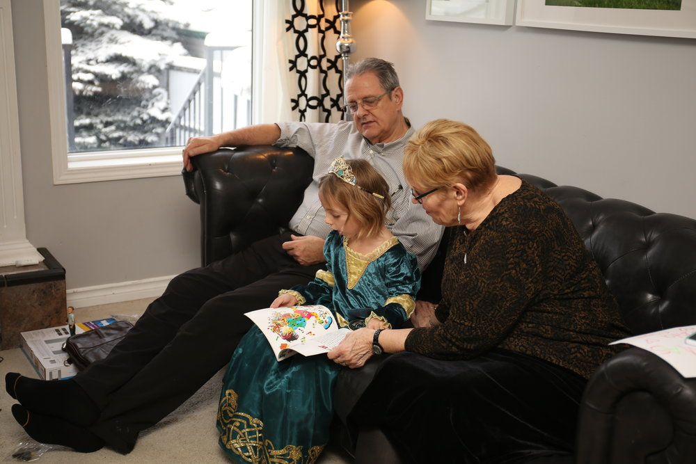 "autumn ""reading"" a story to grandpa and grandma"