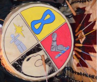 Aboriginal Leadership Opportunity Year drum featuring a symbol for First Nations, an  Inukshuk , and an infinity   symbol for  Métis people . (image -   Victoriaedwards)