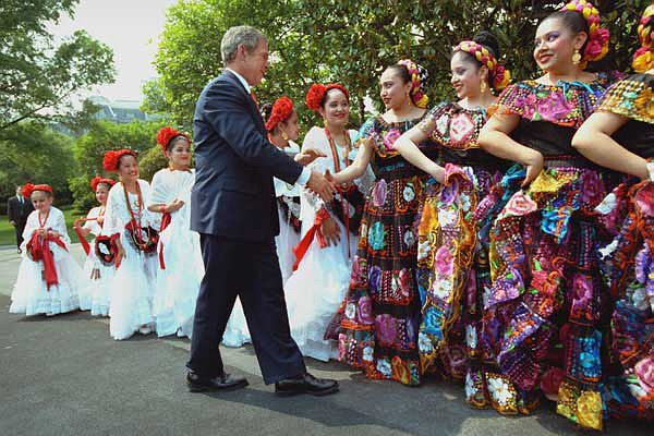 President George W. Bush greeting Cinco de Mayo dancers, via Wikipedia.