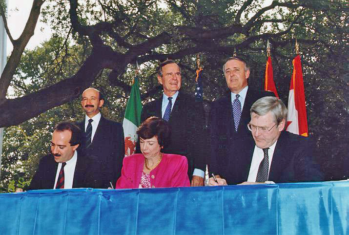 Signing of the North American Free Trade Agreement in 1992, via Wikipedia.