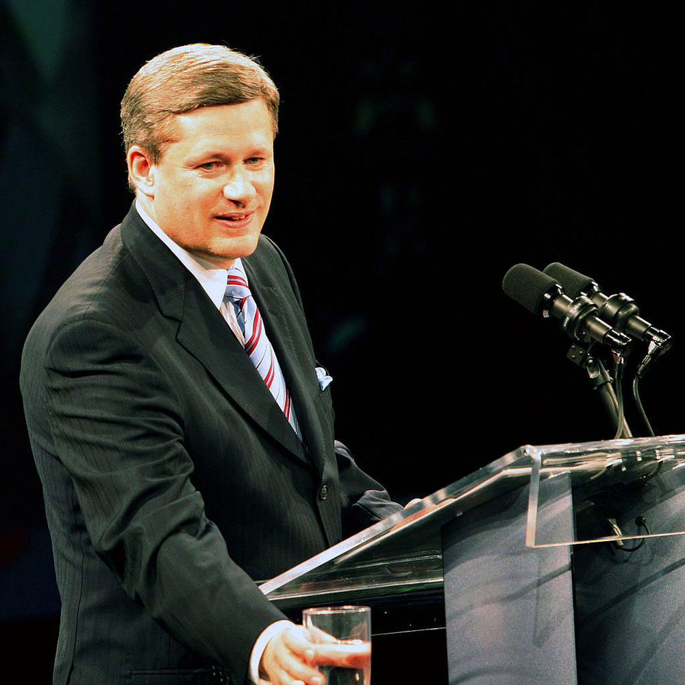 Newly minted Prime Minister Stephen Harper in 2006 addressing party faithful, via Wikipedia.