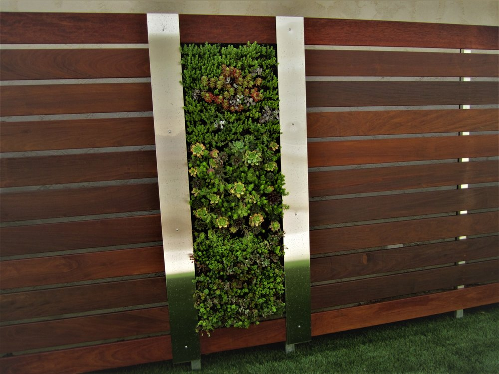 Vertical Fence Design by Singing Gardens.JPG
