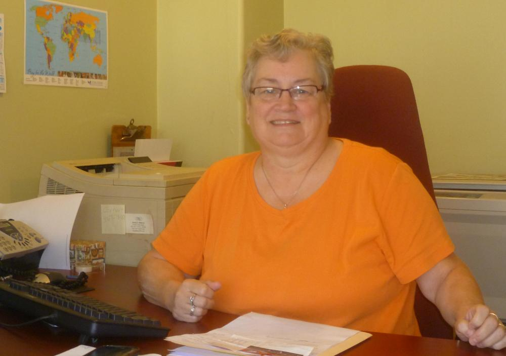Judith at work, Administratively Assisting.
