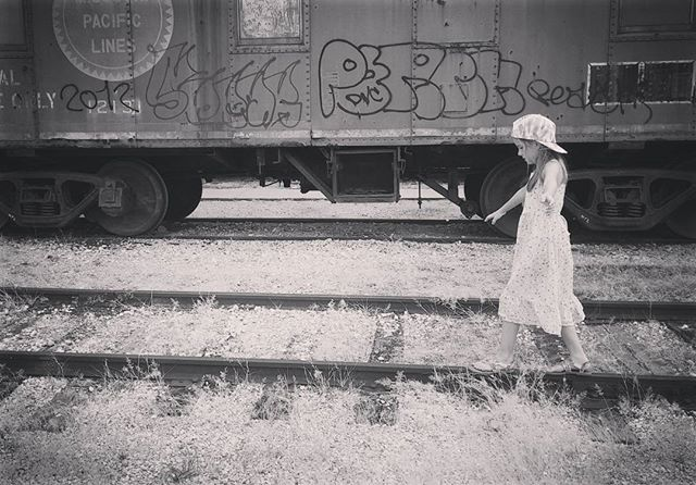 We spent a little time on Galveston Island last weekend. This was taken at the awesome railroad museum they have in downtown Galveston.  I had to get a cute shot of my girl in her sun dress and backwards cap.  #thiswasnottakenonlivetracks #dontuselivetracksforsessions