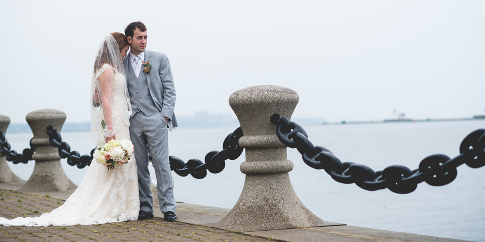 Cleveland Waterfront Bride and Groom Portrait By Brett Loves Elle Photography, Columbus Wedding Photographers.