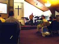 Pastor Tim leading worship