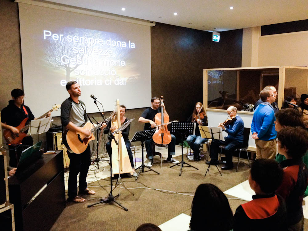 Leading worship at the church retreat in Isola.