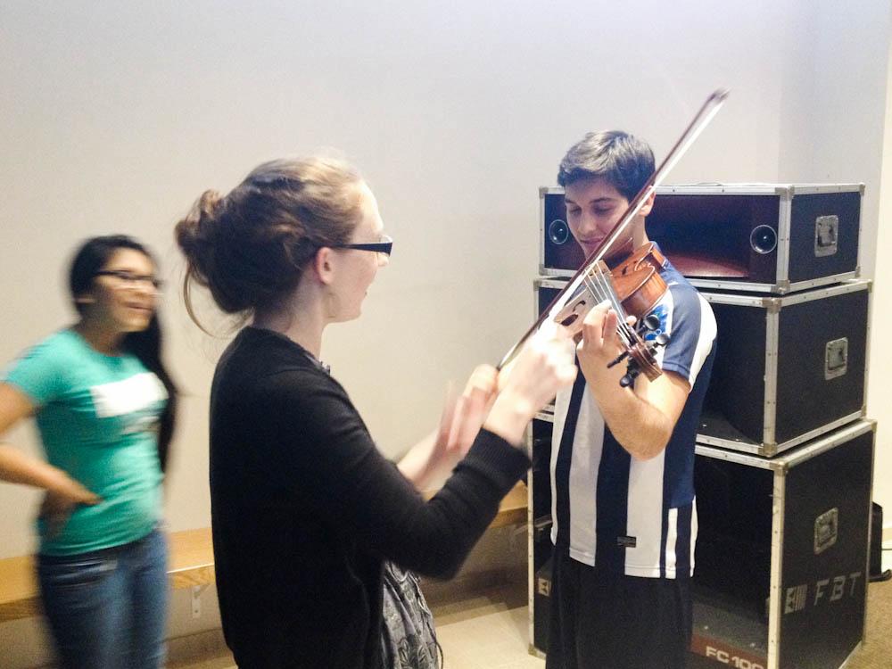 Maren giving Patrizio a brief viola lesson while at Isola.