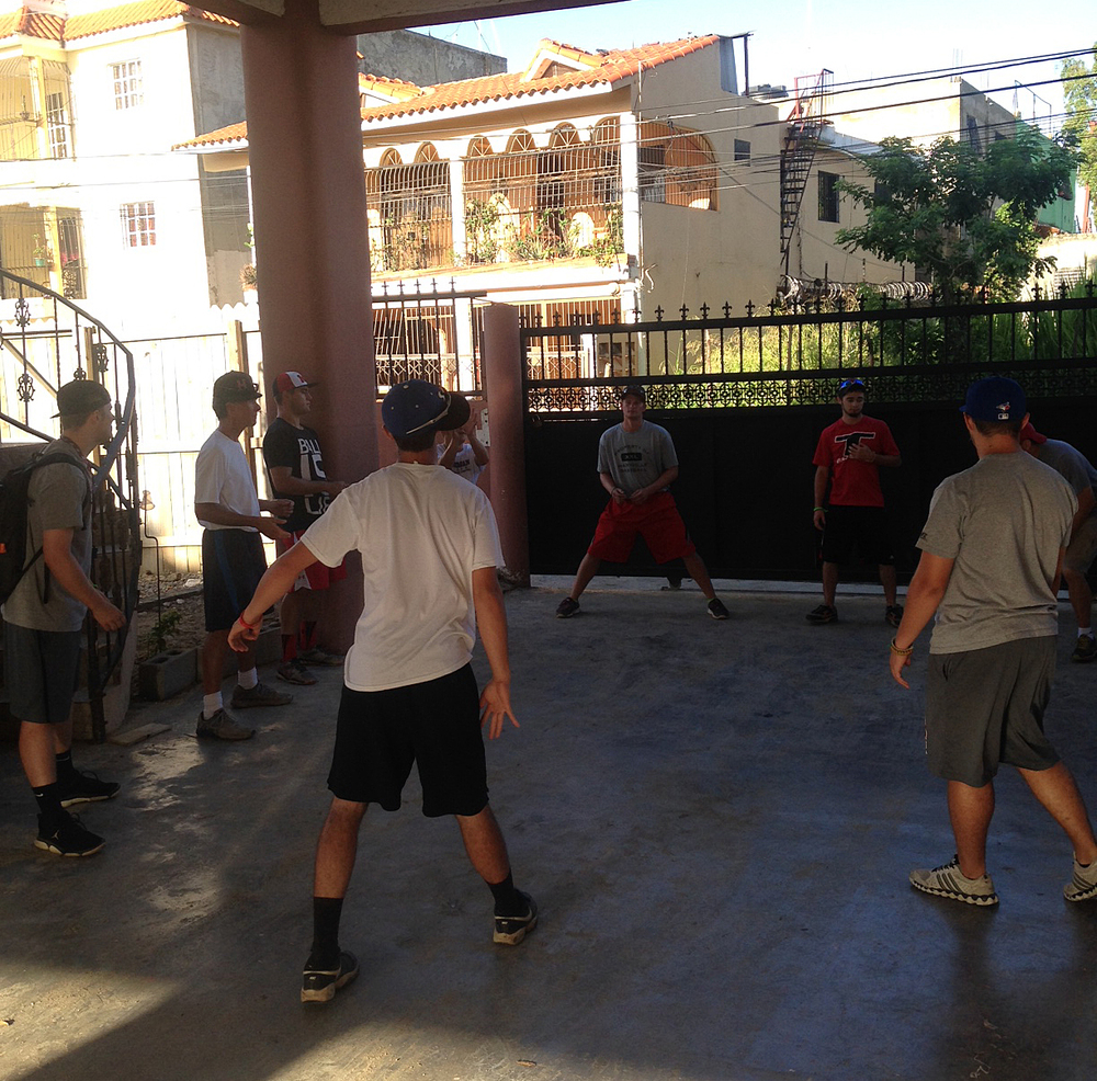 The men of our team can make a game out of anything! Here they are entertaining themselves while we wait for our bus.