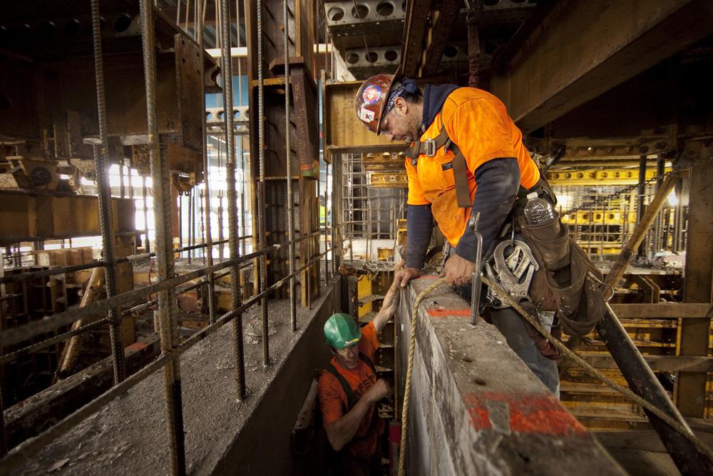 Carpenters work near the 90th floor of 1 World Trade Center in lower-Manhattan.