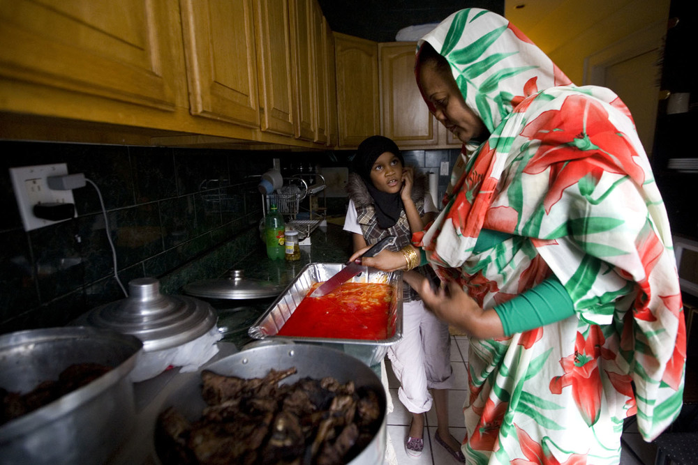 A woman prepares dessert with her daughter in their Brooklyn apartment.