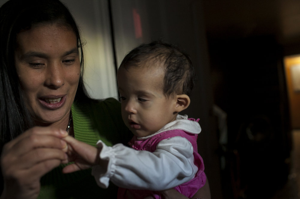 Yugely Nuñez and her daughter who share a genetic retinal disorder at home in Brooklyn.