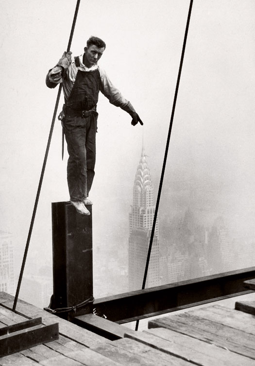 Lewis Hine: Steelworker standing on beam, 1931.
