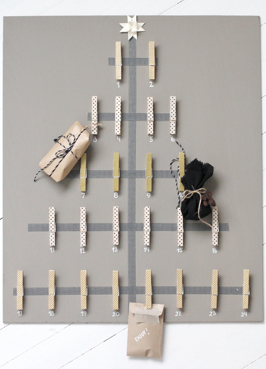 This DIY Advent Calendar Tree is super cool. It has the basic level of craftiness that even my hack-skills can accomplish. Awesome. (via More Design Please)