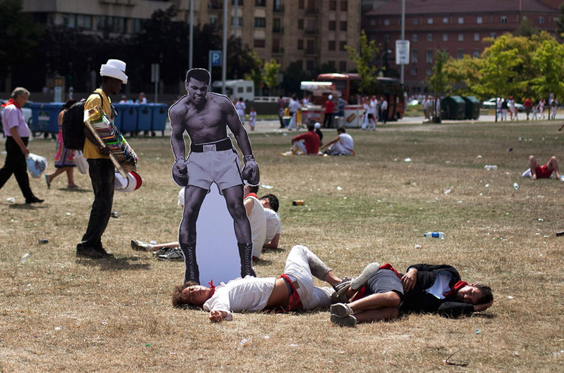 Street artists place cut outs of revelers at the running of the bulls in Spain with hilarious knock-out results.