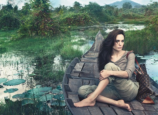 """She's barefoot, wearing her own clothes, no makeup, and toting her own elegantly weathered monogrammed Alto bag. Yet Angelina Jolie looks radiant and completely in her element, reclining on a wooden boat in a verdant, lakeside landscape … People are not used to seeing Angelina in this situation. I like the fact that it's a real moment.""       That was a spokesperson for Louis Vuitton. What on earth? This photo is undeniably beautiful. Annie Leibovitz has done an amazing job of shooting Jolie in the Cambodian landscape.   But honestly. This shot is anything but a real moment. Let's not even get into the fact that she is clearly wearing makeup. Clearly been airbrushed. The woman is brandishing a $10,00+ bag on a river in a country which first inspired her 'humanitarian interests'.   Most of LV's ads feature heavily staged, carefully composed shots that don't ever pretend to be anything else. Which is why they work. This is a whole other story."