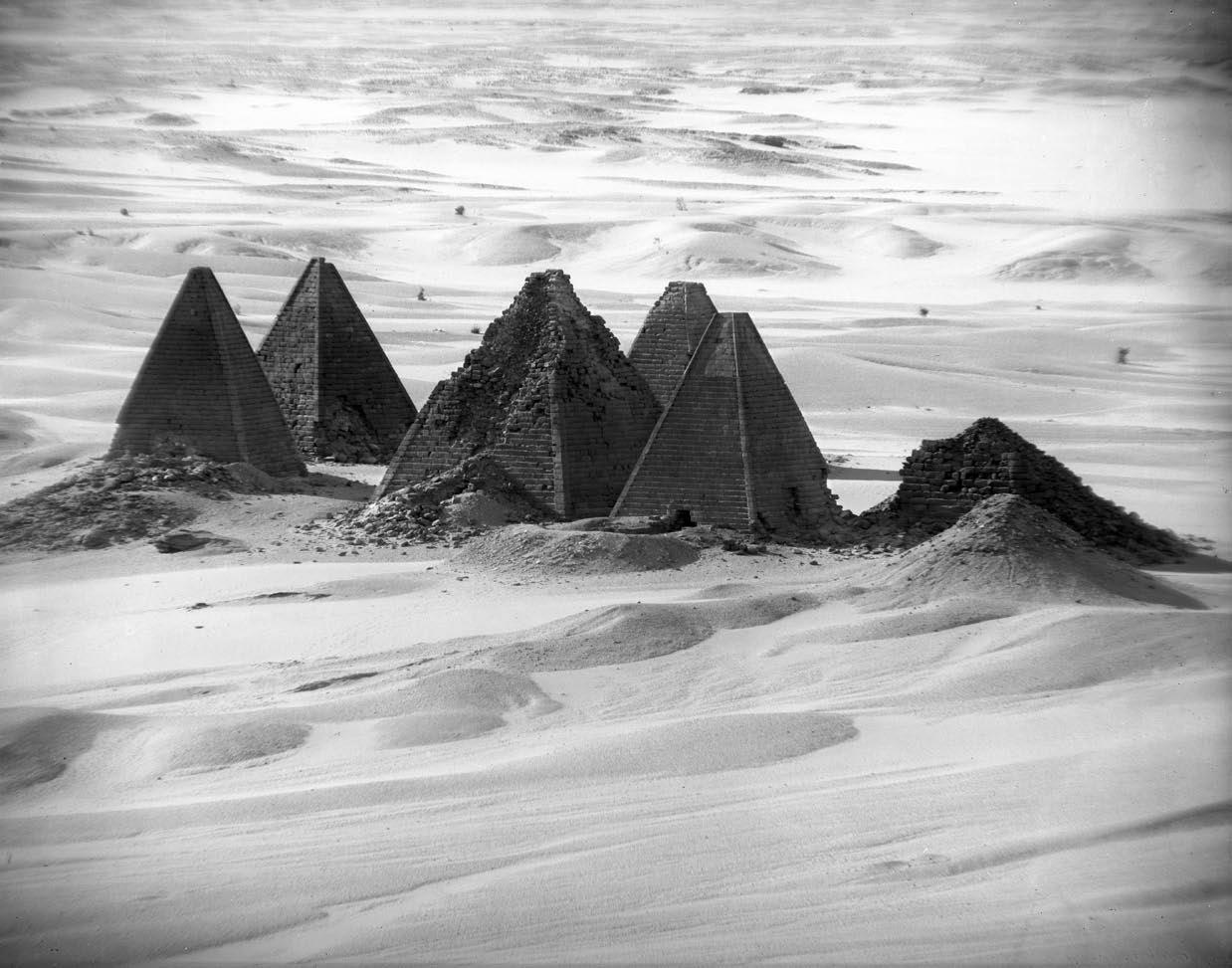 "BIRD'S-EYE VIEW OF PYRAMIDS FROM THE SUMMIT OF GEBEL BARKAL     In 1919, James Henry Breasted would be one of the first scholars to appreciate the use of aerial photography as an aid to archaeology. In 1906, without benefit of an airplane or a hot-air balloon, the height of nearby Gebel Barkal was the perfect vantage point for photographing the pyramids of Napata. This image was taken through a telephoto lens. It has been suggested that the steeper angle of the Nubian pyramids, when compared with the better-known Egyptian pyramids on the Giza Plateau, is the result of the angle of the sun's rays closer to the equator .  SUDAN: Gebel Barkal (Napata) December 1906 Photograph by Horst Schliephack From original 8"" x 10"" glass plate negative Oriental Institute photograph P. 3049   Image and words from:  uncertaintimes :    via: chazhuttonsfsm :"