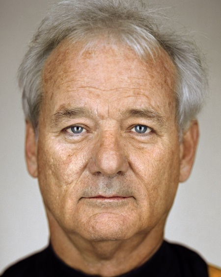 """Bill Murray: The Man Who Knew Too Much       Bill Murray is annoyed. He can't recall the name of the cinematographer who worked on his upcoming film, Passion Play . """"He's Irish, but he's from Australia and he lives in China,"""" says the 59-year-old, Oscar-nominated actor, knitting his brow in thought. """"I talk about him all the time. The crazy Tourette's guy. """"Murray takes a slow sip from a bottle of Brooklyn Lager. """"I worked with him on that movie I did with what's-his-nuts."""" Wes Anderson? """"No."""" Ivan Reitman? """"Jim Jarmusch. It was that one called… """" Broken Flowers ? """"No."""" Coffee and Cigarettes ? """" The Limits of Control ,"""" he says. """"The guy wears platform shoes when he's working. He can't talk for 16 seconds without going into a rant. He once told me this crazy story about living in Hong Kong, next to the world's longest escalator. He'd strip naked in front of his window for everyone to see. But the thing was almost a mile long—the escalator—so by the time people got to the end of it they couldn't remember what building he was in.""""        http://www.blackbookmag.com/article/bill-murray-the-man-who-knew-too-much/20037/P1       via: bbook :"""