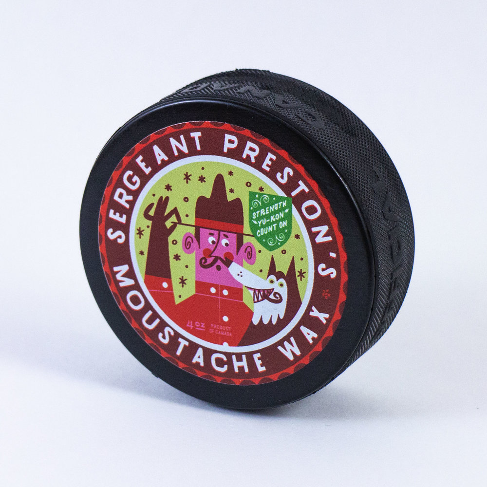 Sergeant Preston hockey puck for The Collective Good