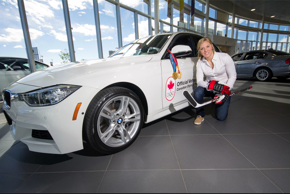 Meghan pictured with her brand new 335i from BMW.