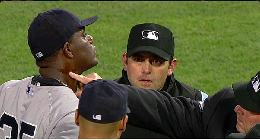 New York Yankees pitcher Michael Pineda being inspected by umpires at Fenway Park on April 23, 2014 in the 2nd inning.  He was ejected from the game and on April 24, he was suspended by MLB for 10 games. The same night that the US Women's Olympic Hockey team members were to be honored by the Sox.