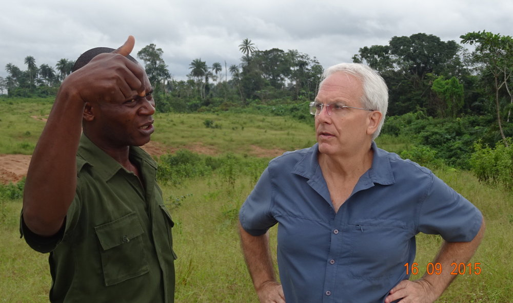 ALERT director Bill Laurance inspects the road clearing near Cross River National Park, guided by a park guard  (photo by Mahmoud Mahmoud).