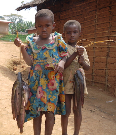 Village kids in the Congo proudly displaying their catch  (photo by Bill Laurance)