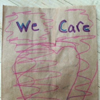 Students decorate bags to be filled with lunches for local homeless