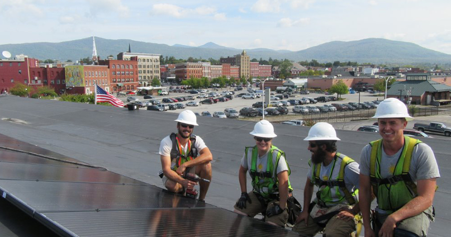Solar panel installation in downtown Burlington, VT. Photo courtesy of BROC Community Action.