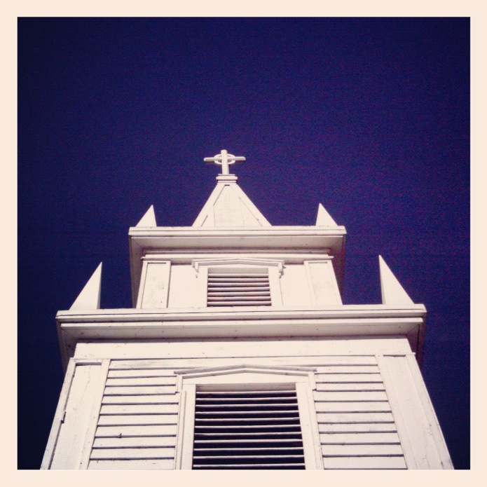 white steeple blue sky