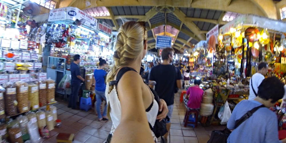 """Nothing screams """"rob me"""" like two white people taking pictures of fruit in a busy market."""