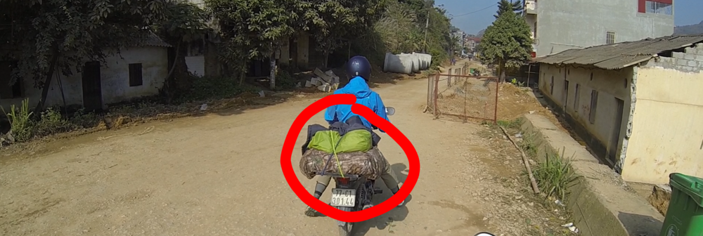 Somehow both laptops survived two months of Vietnamese highway riding in that camo bag...