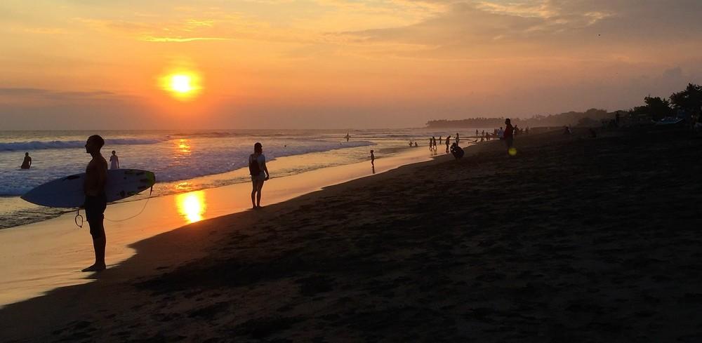 surfer at echo beach sunset
