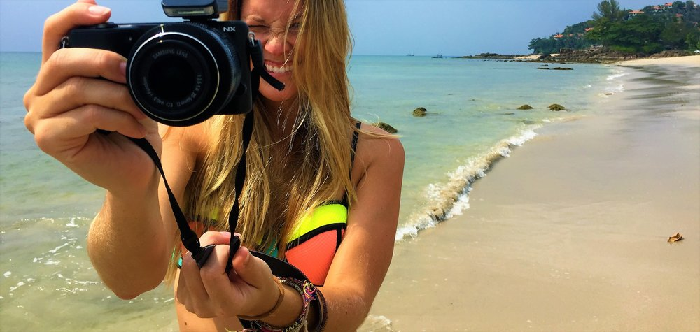 bikini and camera on beach