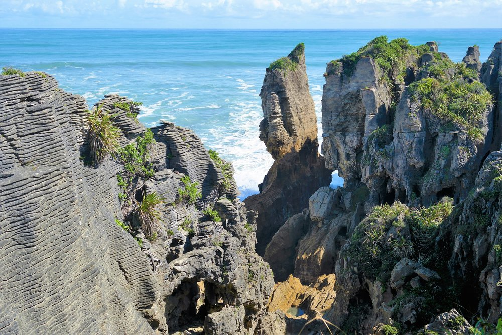 The bizarre Pancake Rocks are a REAL PLACE that are a must for any NZ bucket list.