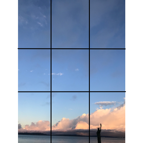 That's because the key elements of the photo — the clouds, the mini-Statue of Liberty, the horizon line along the water—do not lie on a grid line or at grid-line intersections.   Basically, there's too much sky and it overwhelms the more interesting elements in the photograph.