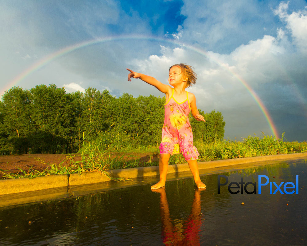 Photographer snaps epic portrait of his daughter under a rainbow - Petapixel.com
