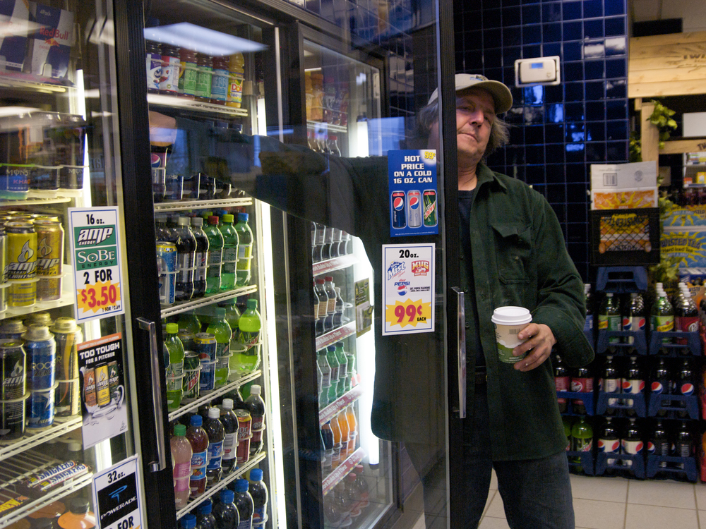 (04/18/09) On his way to the dock, Carter Newell stops in at a local gas station for a cup of coffee and a soda. He has about eight or nine hours of hard work ahead of him.