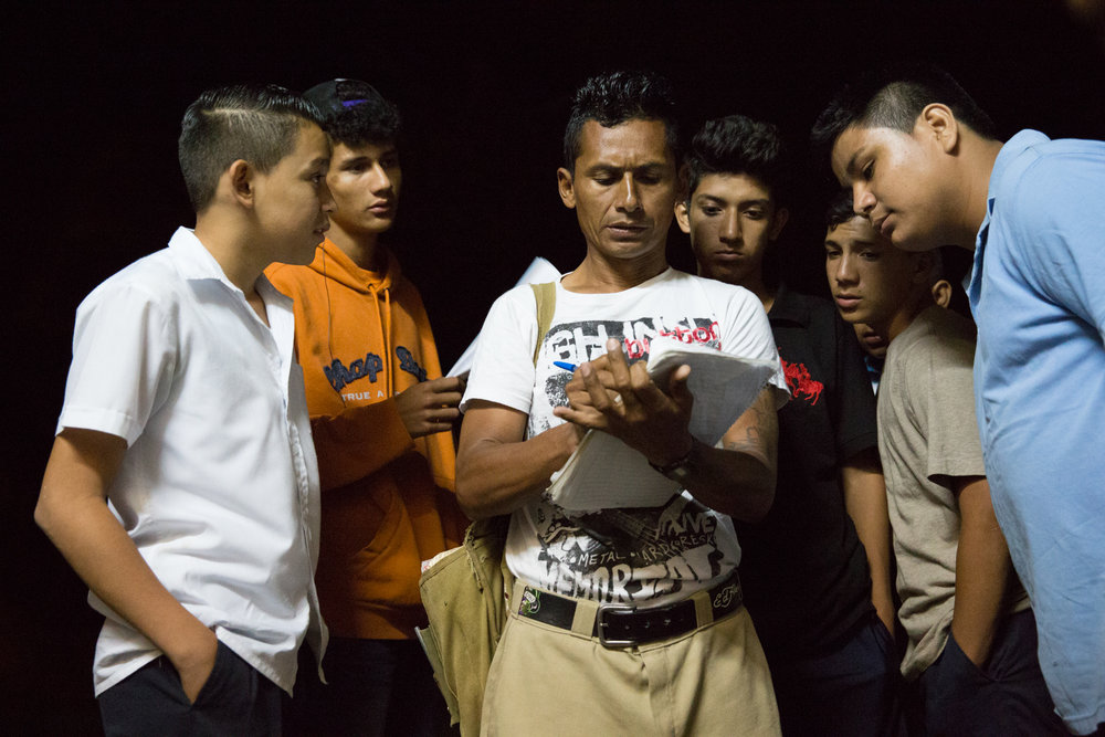 Local youth crowd around Jairo Blanchard (center) as he signs them up to join a soccer league in Matagalpa, Nicaragua.