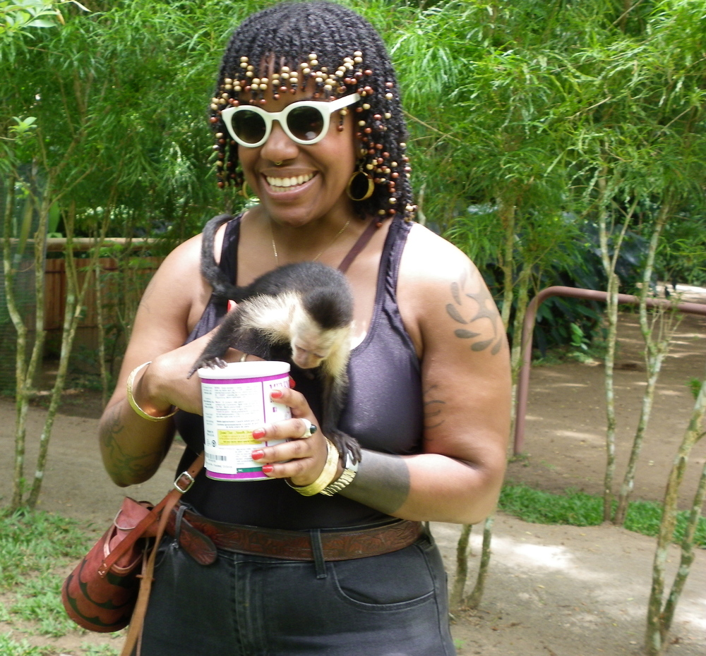 with a monkey at the Jaguar Rescue Center