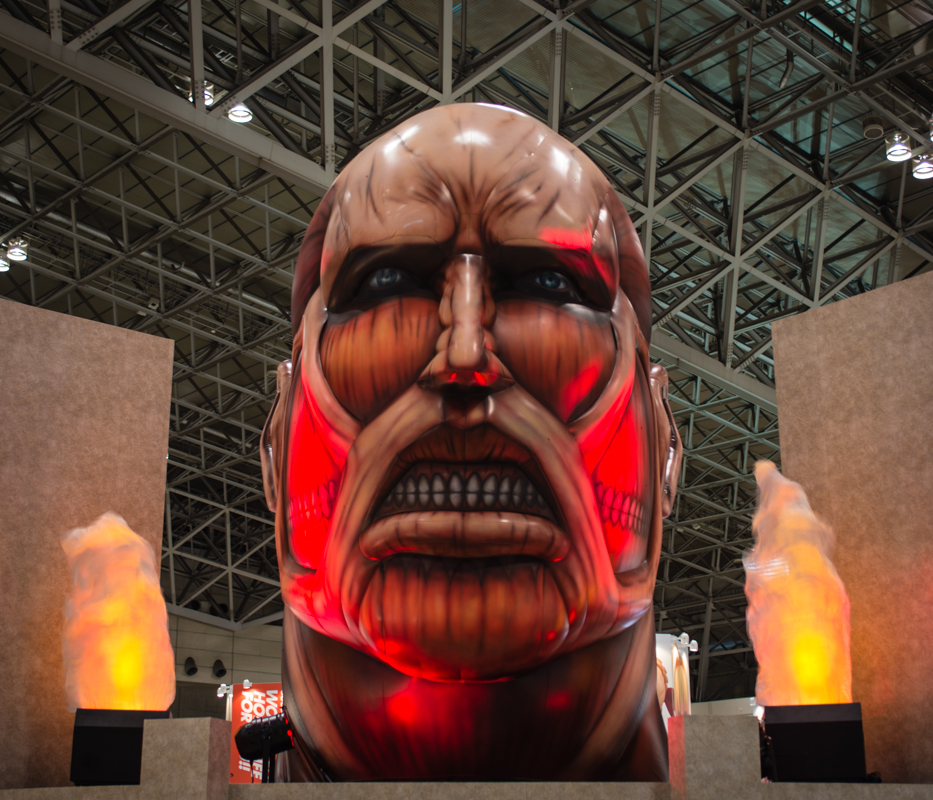 The  Colossal Titan cast long shadow over guests as they filed into the Makuhari Messe convention center.