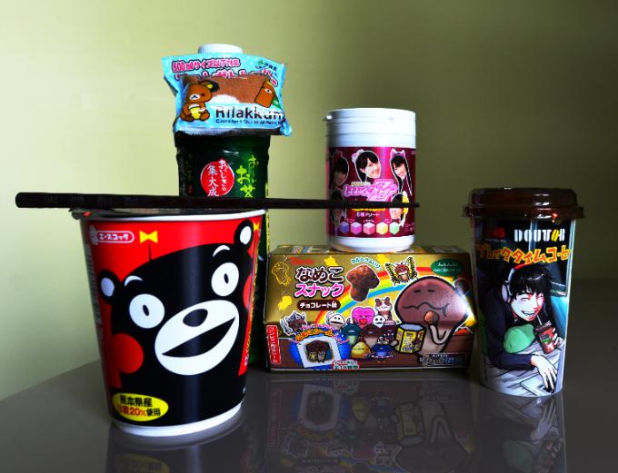 Kumamon cup noodles, Momoclo gum, tea with Rilakkuma bonus, Mushroom Garden snacks and Mitsuro Kubo coffee