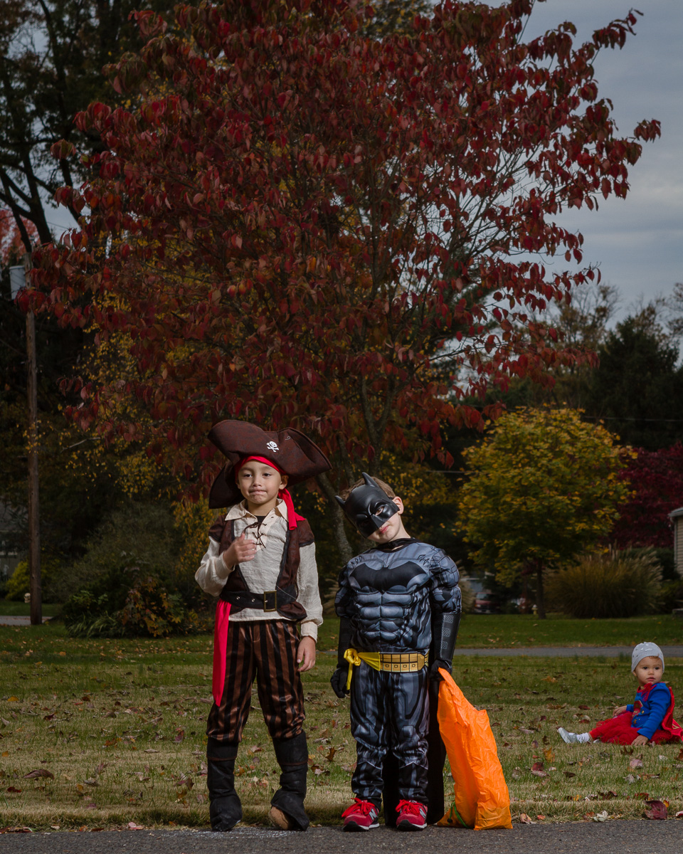 Aus (Pirate) and Ryan (Batman) are good friends who came out with their parents to trick-or-treat. (My little one (Super Girl) felt the need to photo-bomb.)