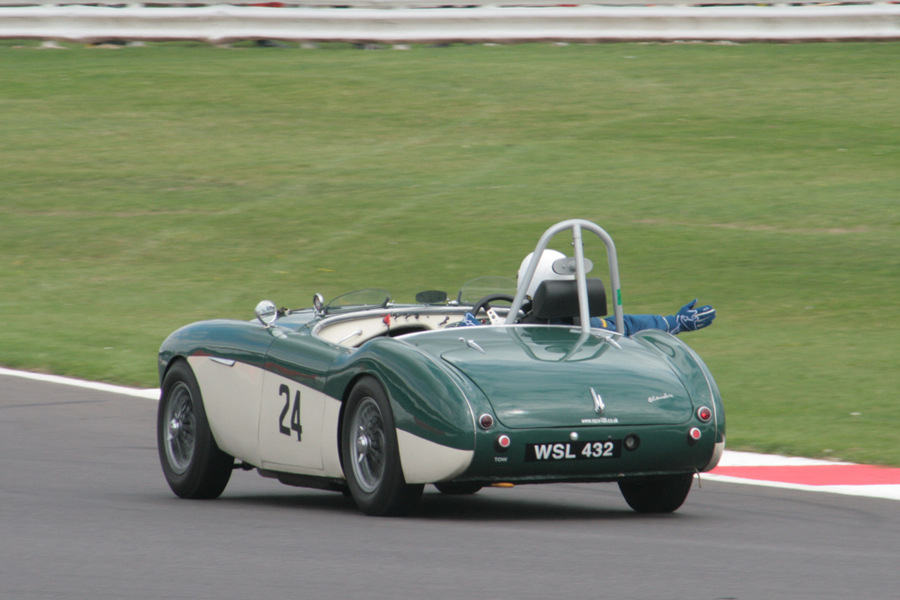 Track etiquette. James Wilmot-Smith brings his Austin Healey 100M in for the compulsory pit stop